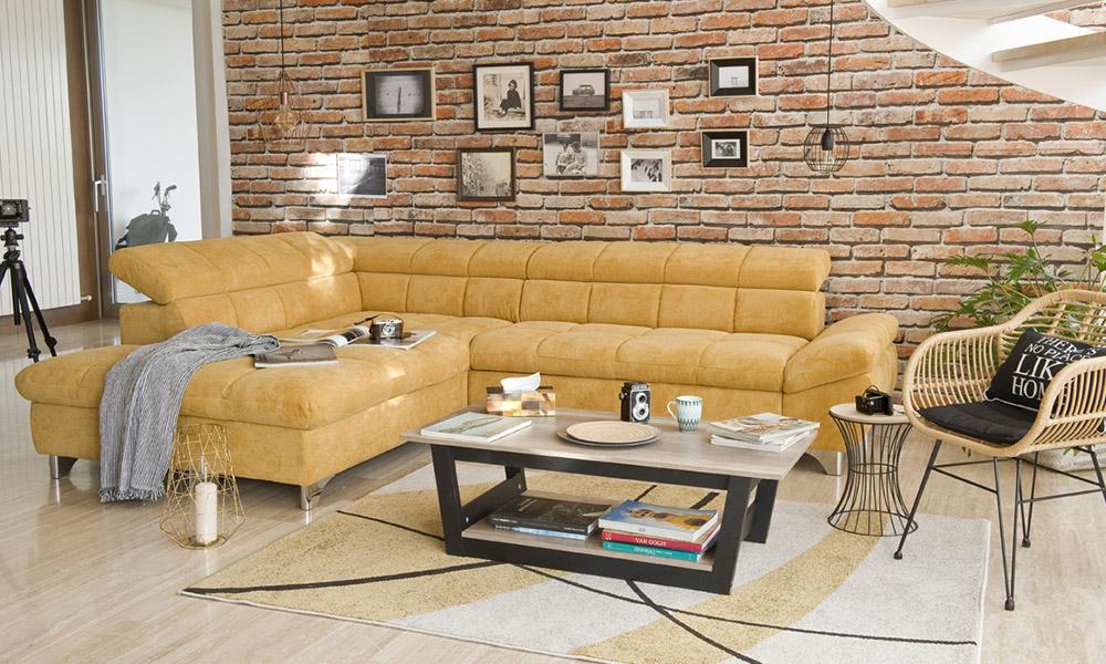 Fular plaid multiusos RAYAS en gris claro sobre sofa rinconera GÉMINIS