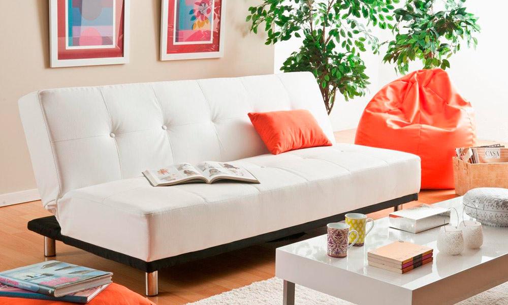 colocar cuadros encima del sofá